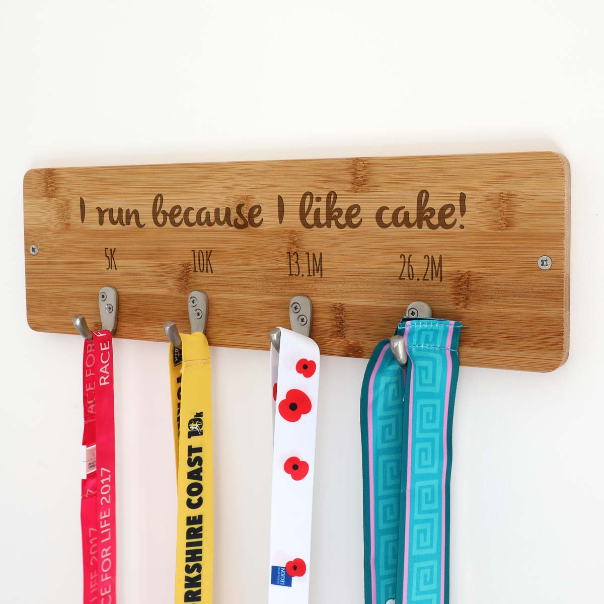 Personalised I Run Because I Like Cake Medal Holder