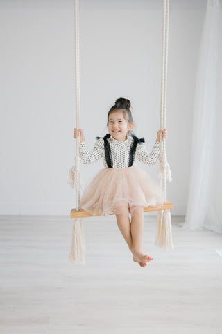 Bright and airy girl tutu swing