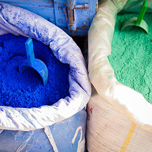 large sacks of powdered blue and green dyes