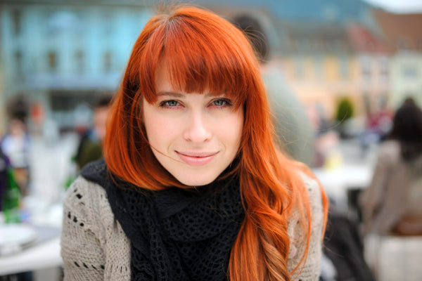 redhead bangs woman long oblong face hairstyles face shapes toppik blog post