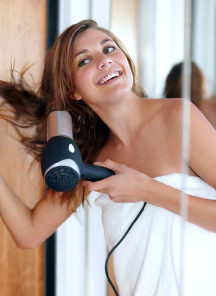 Blowdrying-hair-upside-down-volume-growth-toppik-blog