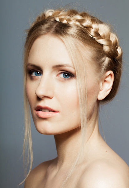 crown braid hairstyle side view blonde hair woman favorite holiday hairstyles toppik hair blog