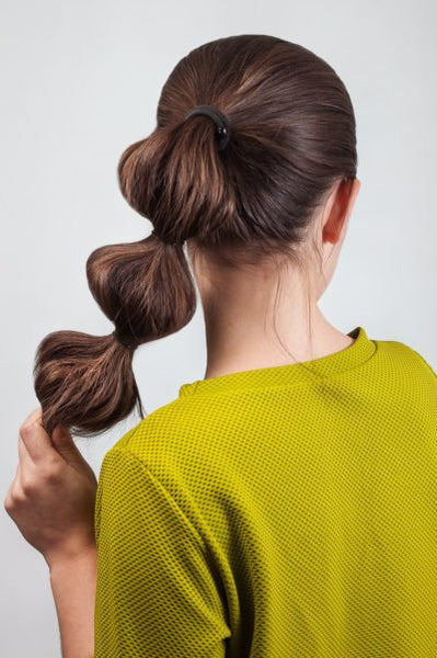 bubble-ponytail-long-hair-brunette-woman-best-gym-hairstyles