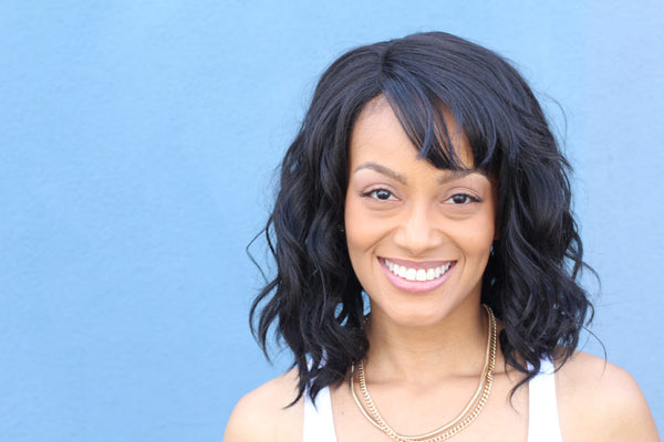 black hair african american woman smiling side swept bangs heart shape face hairstyles ace shape