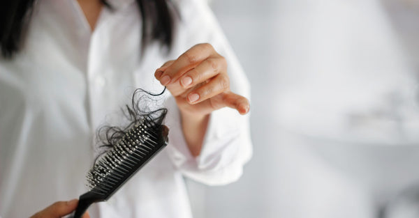 woman losing hair hairbrush thinning hair loss weight loss and hair loss toppik hair blog