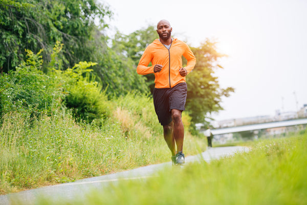 man with thick beard jogging