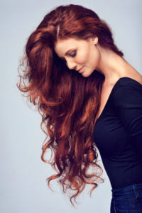 woman-long-red-hair-side-iron-deficiency-hair-loss-anemia