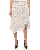 "Simone Rocha White Floral Crochet Mesh Overlay Skirt.  Below knee length full skirt with raised hemline at left knee, silk lined, no waistband.  Marked size UK6 (USA 2) but can fit a USA 4/6 as waist measures 27"", total length is 26"".  Our model is 5'10"" without heels. 65% cotton, 32 polyamide, 3 poly.  Crochet is 100% poly and lining is 100% silk.  Excellent preowned condition."