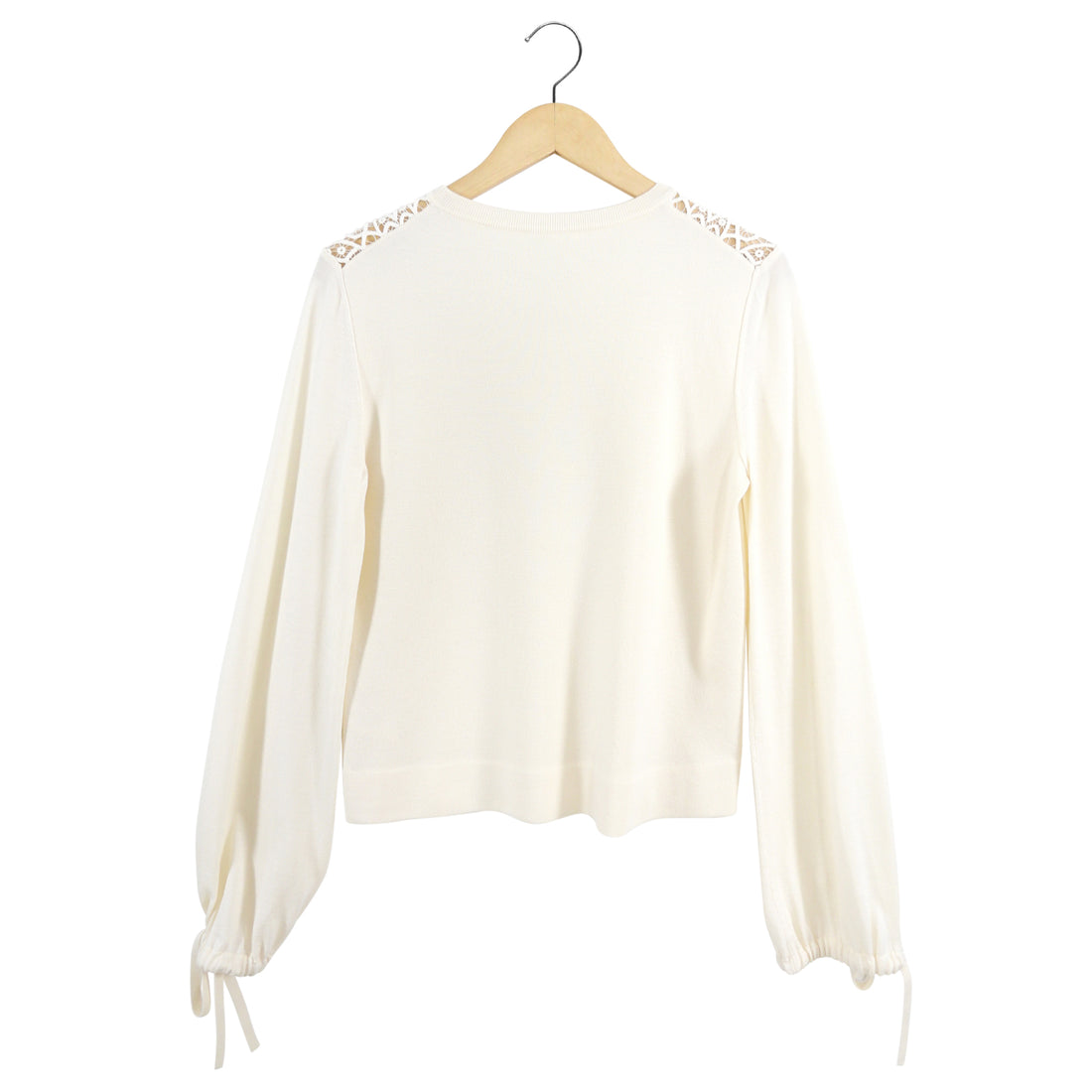 "Details: Cream knit jersey top with sheer broderie anglaise lace trim at shoulders and neckline, drawstring tie sleeves, straight cut body. Closures: pullover Marked size: L (fits USA 8).  Previous owner wears USA 8 Chest: 40 Shoulder seams: 16"" Sleeve: 28"" Back neck to hem: 23.5"" Material: 70 wool, 30 silk.  Lace:  80 cotton, 20 poly Condition: Excellent pre-owned"