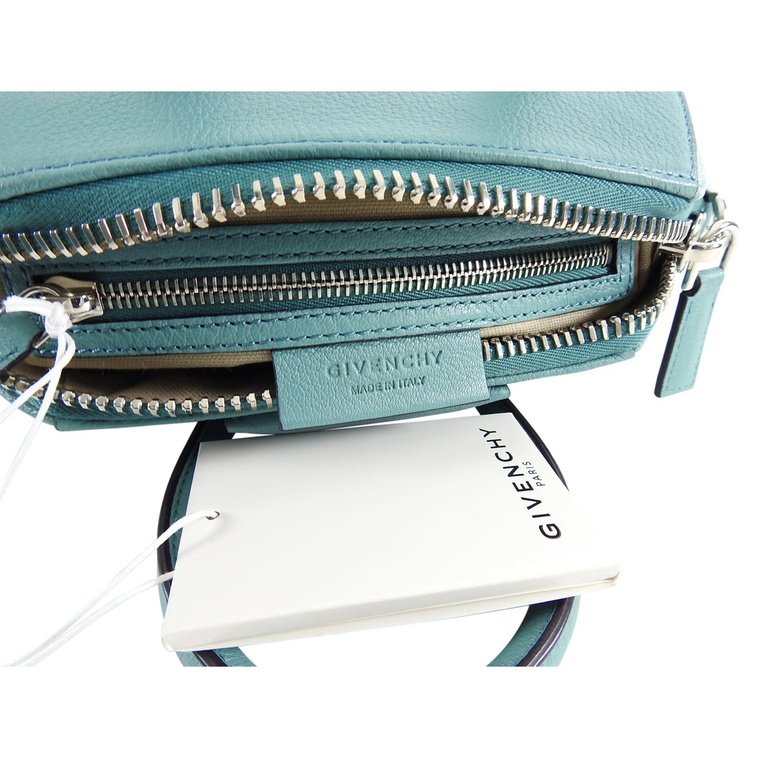 "Givenchy Aqua Blue Antigona Mini Crossbody Bag.  Silvertone metal, double rolled leather handles, long crossbody strap.  Measures 8.75 x 75 x 5.25"" with a 22"" strap drop.  Excellent condition - as new except for a small blemish on back top handle as pictured."