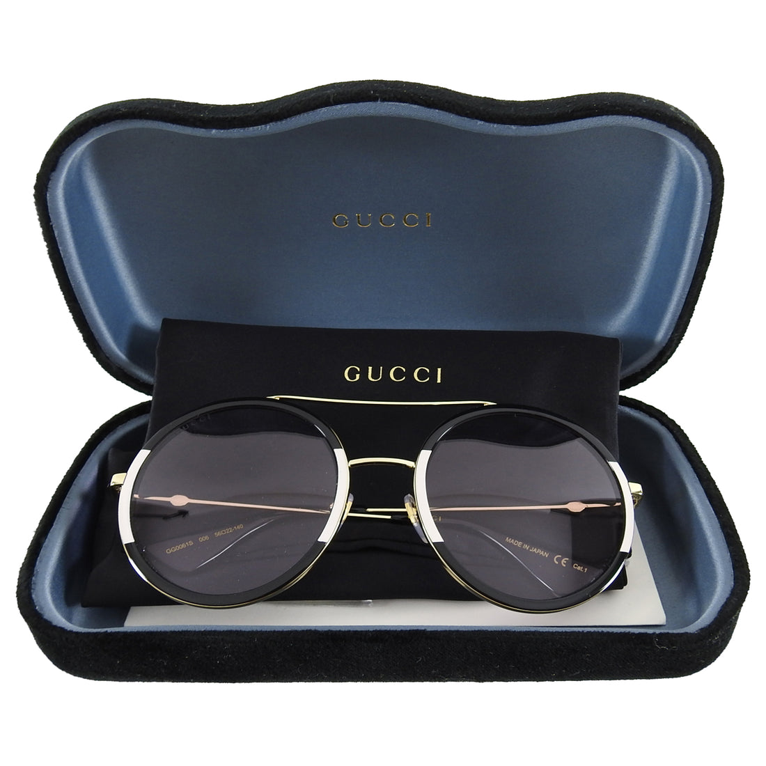 Gucci Black and White Round Light Tint Sunglasses GG0061S