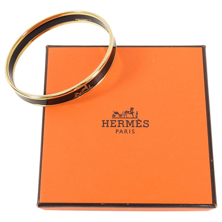 Hermes Printed Enamel Narrow Black and Gold Caleche Bangle