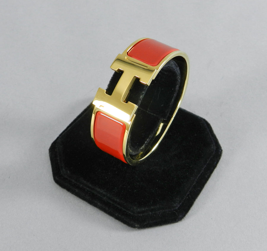 Hermes Red and Gold Clic Clac Bracelet PM