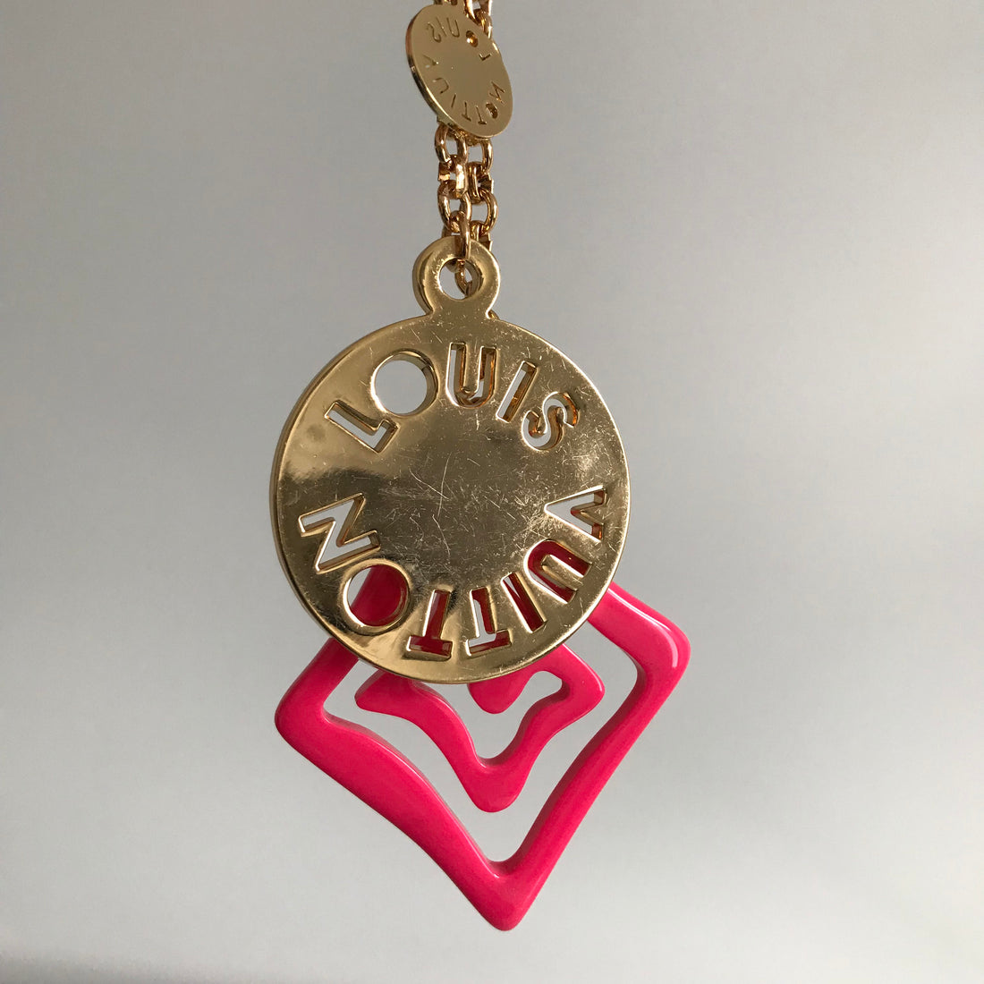 Louis Vuitton Pink Acrylic and Gold Logo Medallion Key Chain
