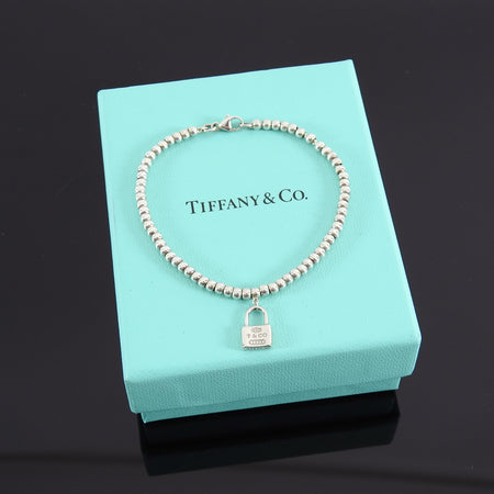 Tiffany and Co. Mini 1837 Sterling Bead Bracelet with Lock Charm