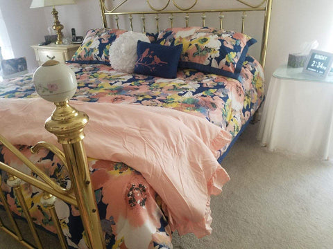 Reyna Throw on Floral Watercolor Comforter Set in master bedroom
