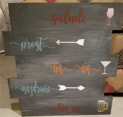 Cheers in 5 languages on re-purposed pallet wood.