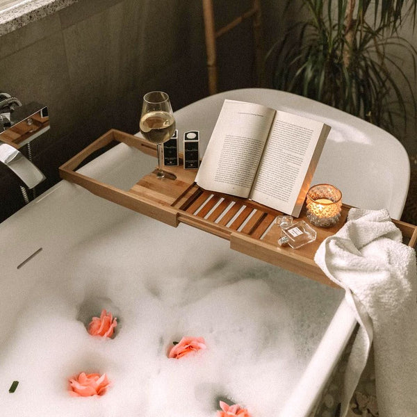 Bubble bath with book and white wine