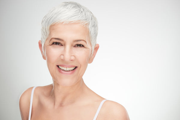 Beautiful older lady with clear youthful glowing skin