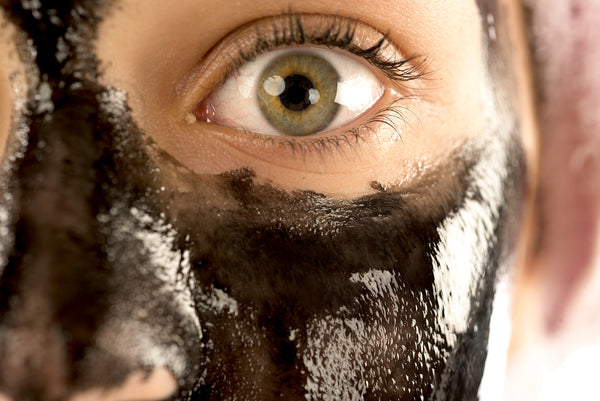 Woman tries black charcoal peel-off face mask