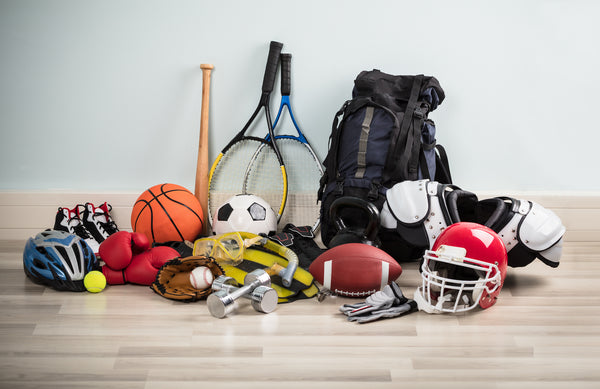 Assorted sports equipment helmets protective gear