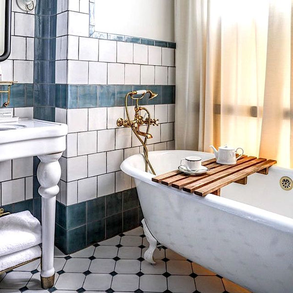 Blue and white tiled bathroom with clawfoot bathtub