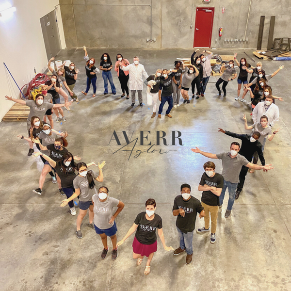Averr Aglow staff poses in heart shape with masks on