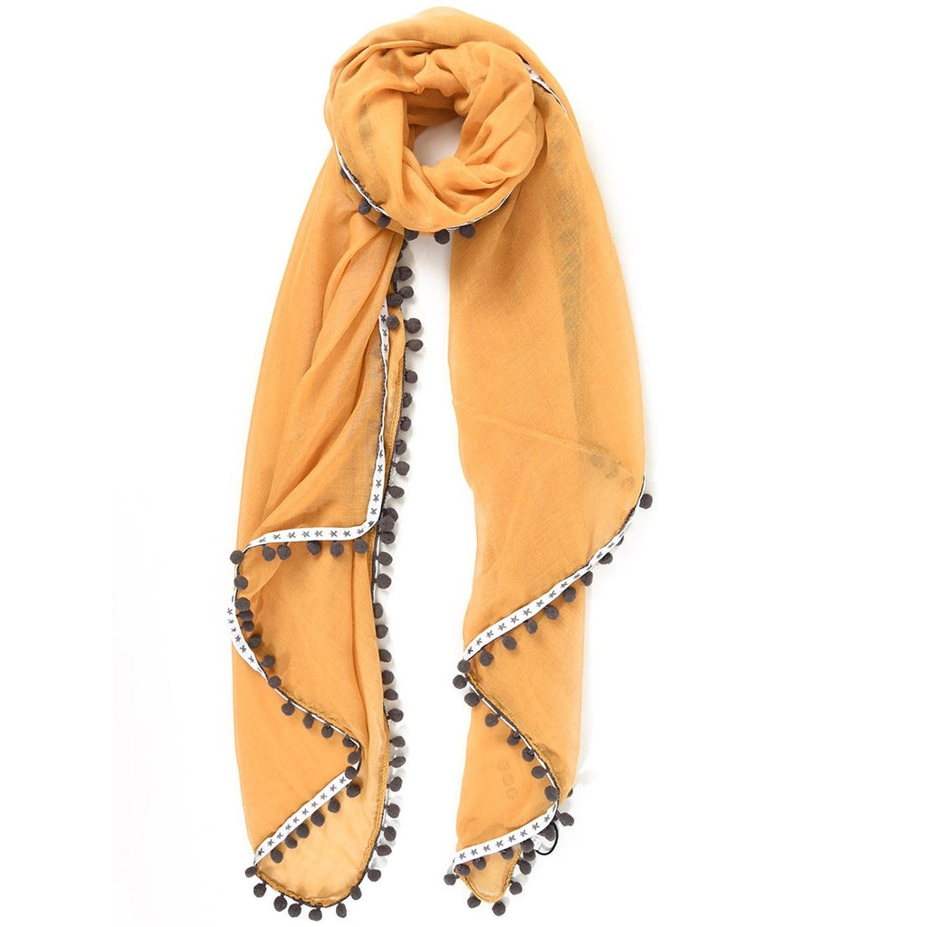 mustard scarf with grey star trim and pompoms