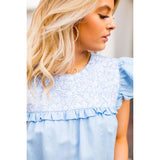embroidered top + light blue