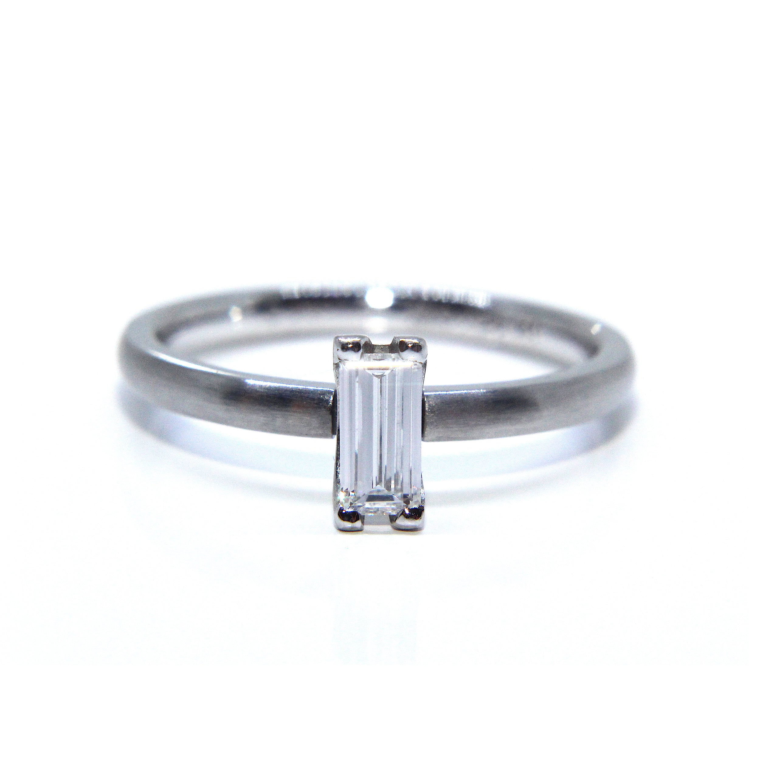 center stones tapered platinum white in stone with baguette and ring side engagement three heart diamond shape rings