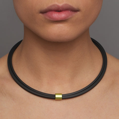 Ursula Muller black rubber and lemon green alminium necklace