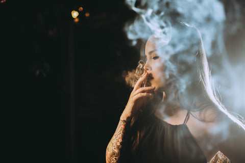 Asian Girl Smoking Rolling Papers