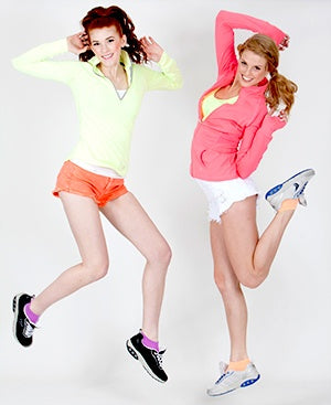 two women jumping with Therafit shoes on their feet
