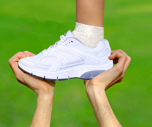 Foot in Therafit shoe being held in the air