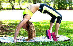 Woman doing a backbend wearing Therafit sneakers
