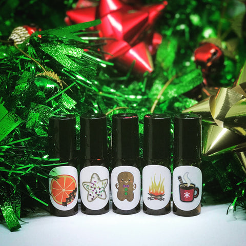 Holiday Classics mini roll on set! Five 5ml roll-on fragrances: Sugar cookie, gingerbread, orange clove, hot cider, fireplace.