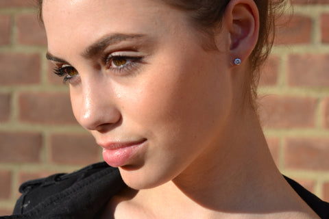 Model with three quarter round brilliant cut diamond studs