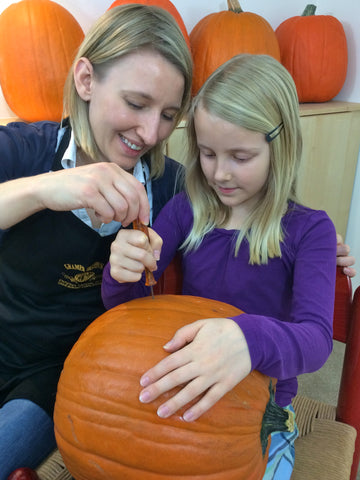 Mother and daughter carving