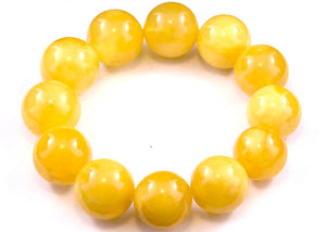 16 - 18mm Round Yellow Baltic Amber Bracelet on white