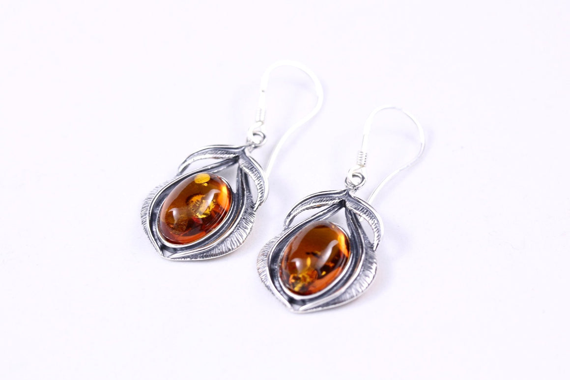 Cognac Baltic Amber and Sterling Silver Feather Earrings on stand
