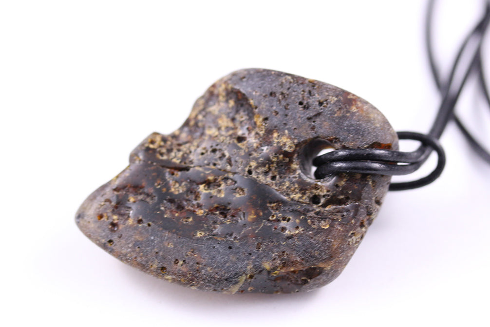 Rustic Baltic Amber chunky pendant on leather thong