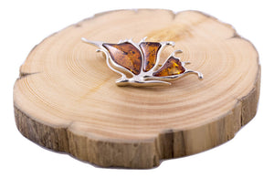Baltic Amber and Sterling Silver Butterfly Brooch on wood