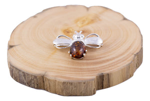 Baltic Amber and Sterling Silver Bee Brooch on wood