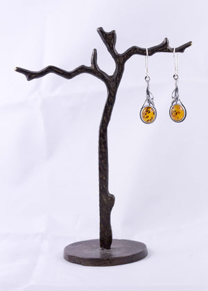 Cognac Baltic Amber and Sterling Silver Organic Drop Earrings on wood