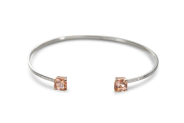 Solid white gold bangle featuring peach-color morganite