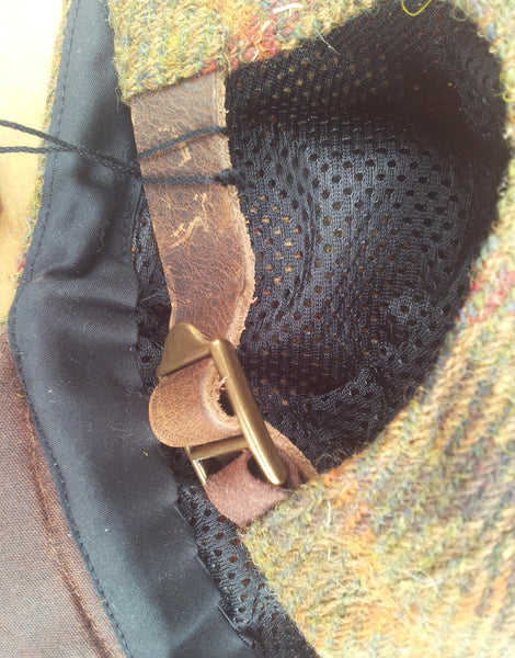 Bespoke made to order cycling cap (all sizes catered for) handmade in wonderful plaid Harris tweed in a myriad of browns, reds, and orange. HORWEEN leather strap.