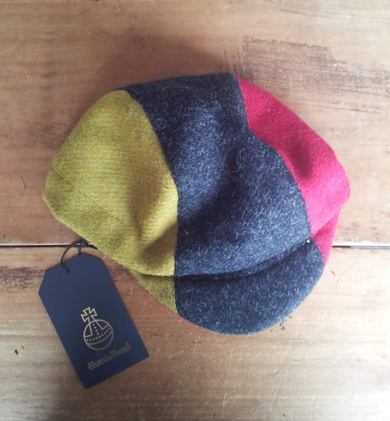 Bespoke made to order cycling cap (all sizes catered for) in wonderful Harris tweed. Horween Leather Strap. Red, Charcoal, And Acid Green.)