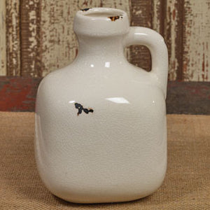 Small aged white jug