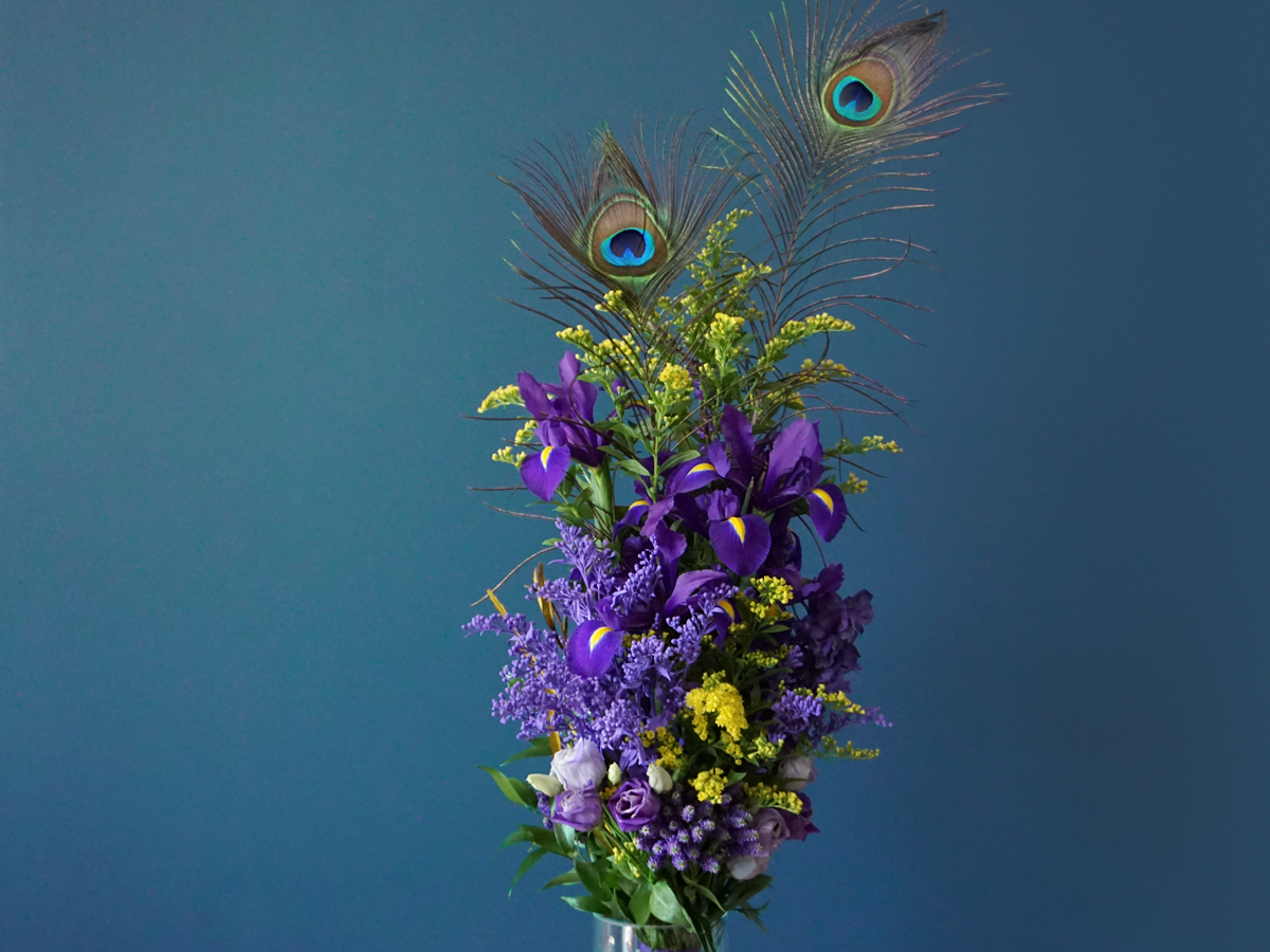 Flower bouquet with peacock feathers