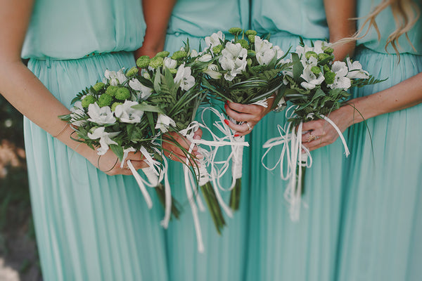 Bridesmaids In Mint Dresses Holding Bouquets